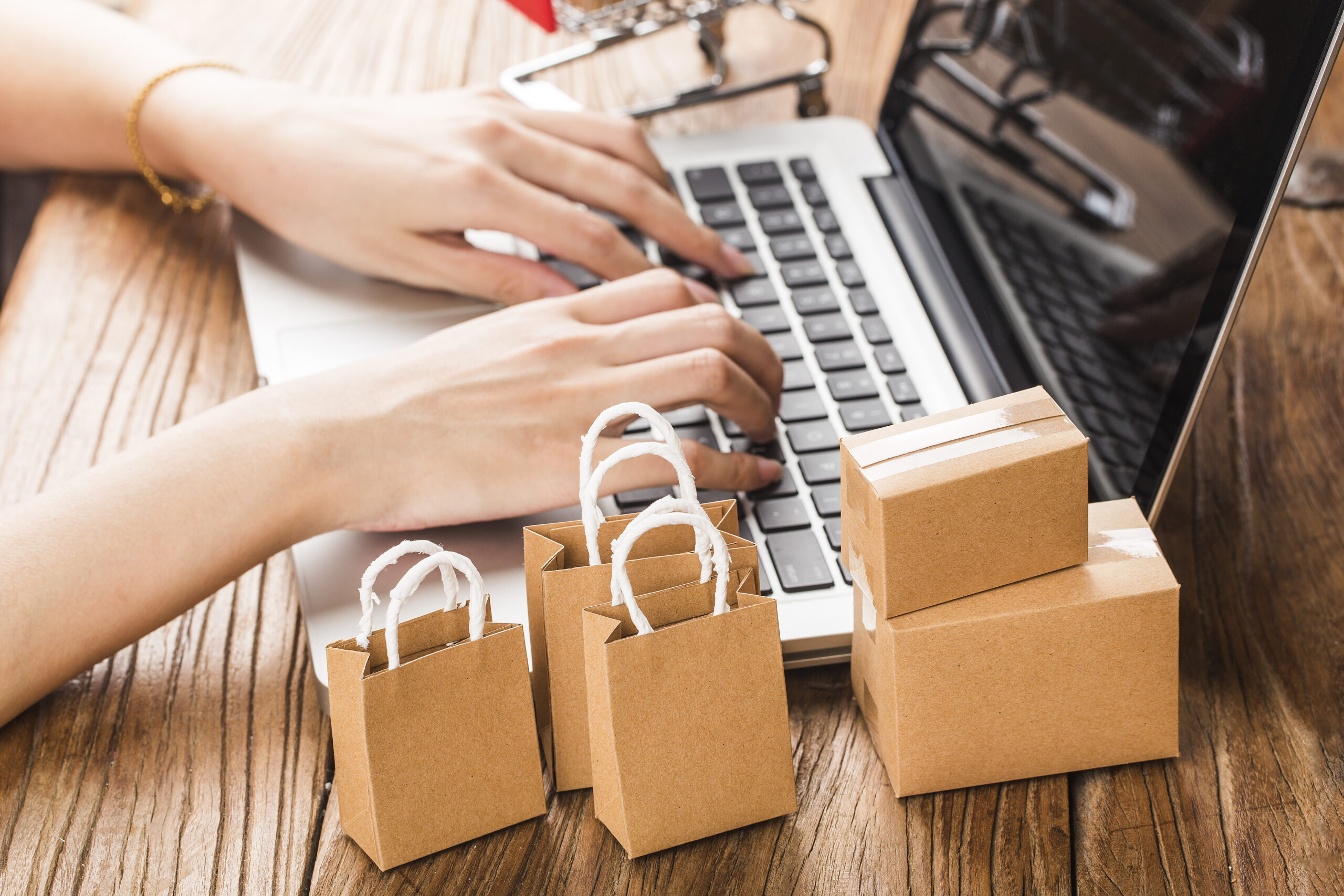 shopping online at home concept.Cartons in a shopping cart on a